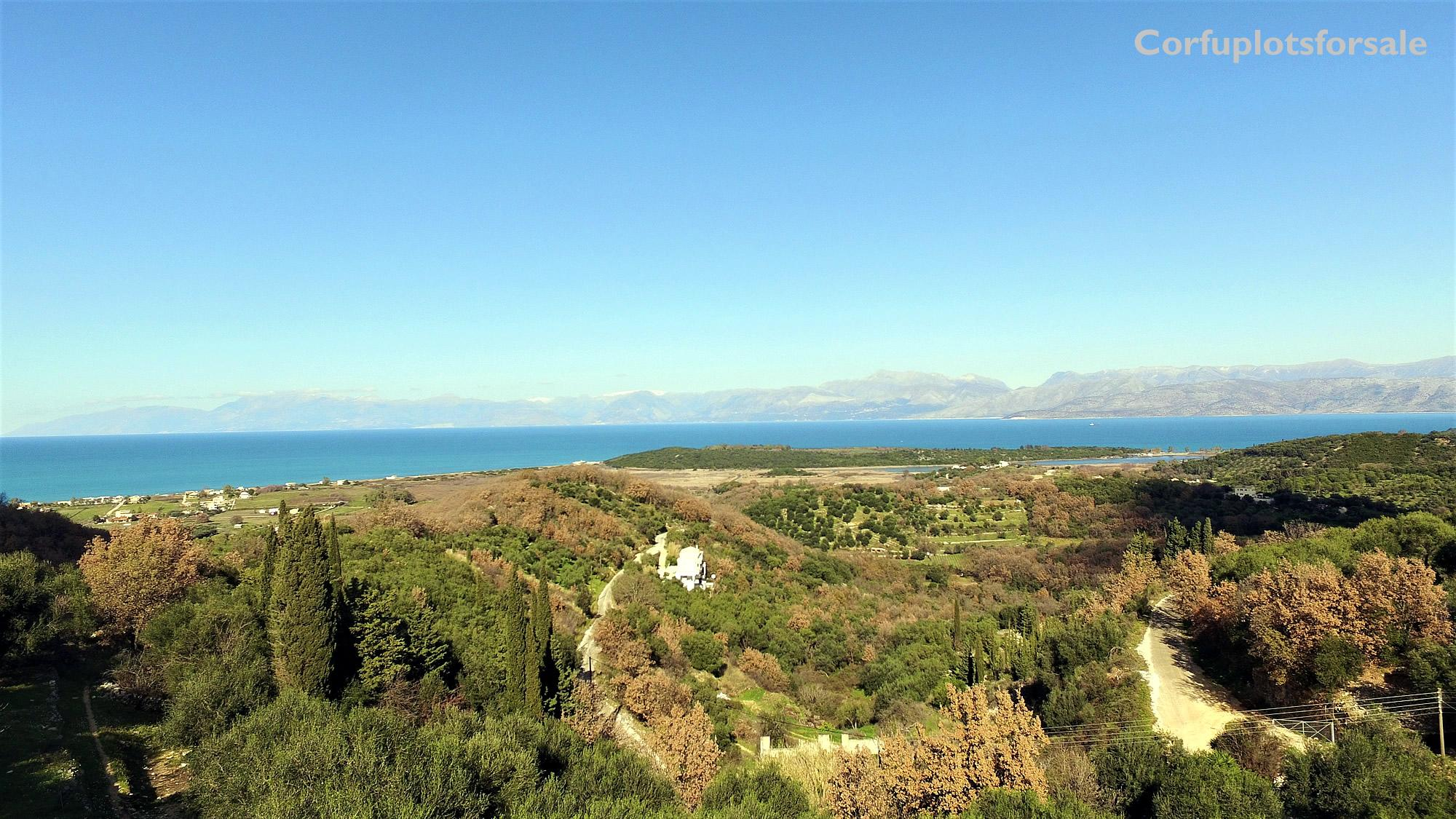 A full of greenery piece of land with sea view only 1.500m from the beach