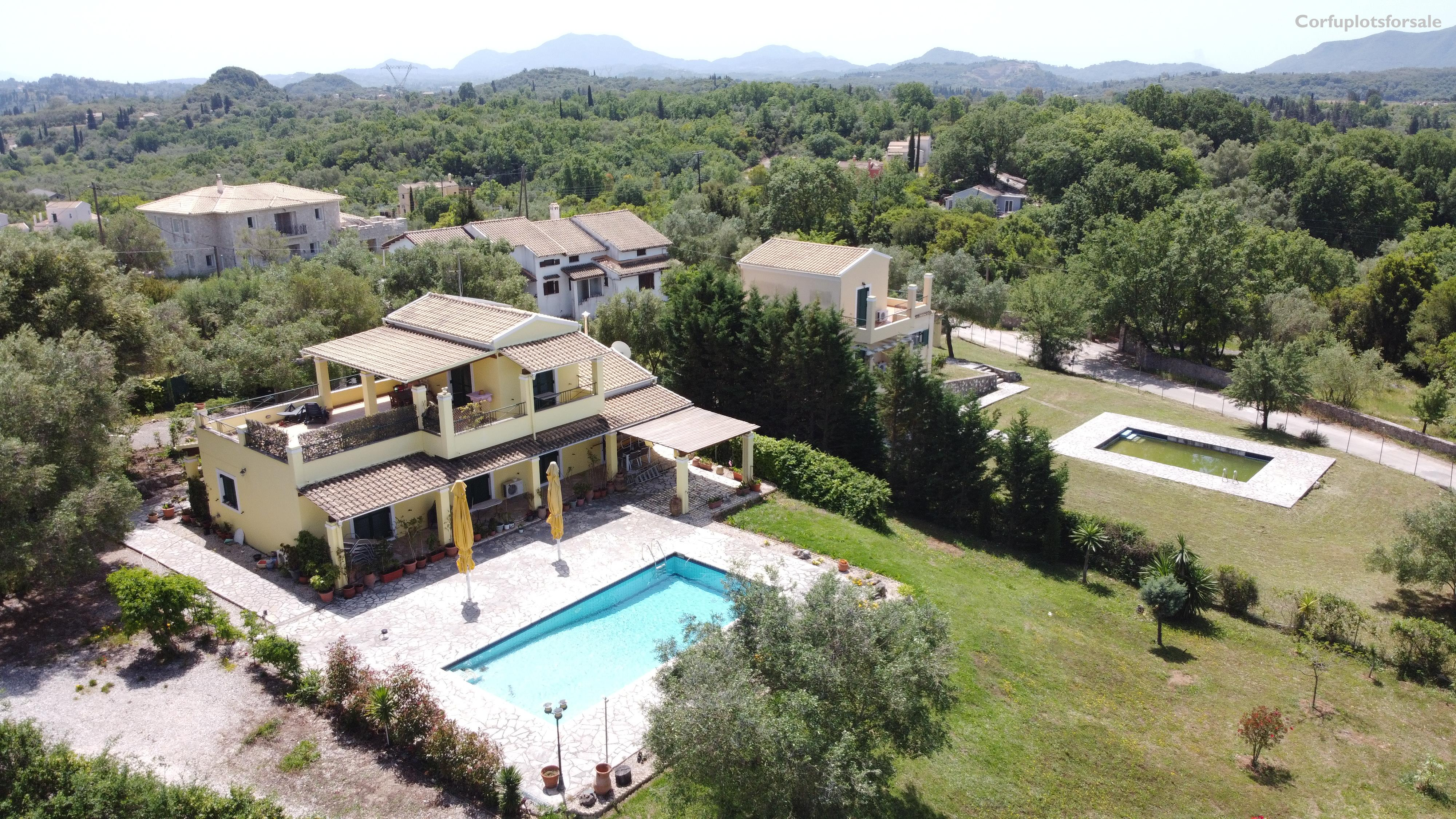 Two attached villas with pools in Poulades